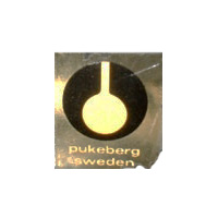 Pukeberg Swedish glass clear plastic label - white text.