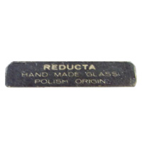 "Import label used by British importers ""Reducta"", found on Polish glass vase."