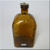 Ekenas Glasbruk Swedish labelled amber glass bottle/decanter.