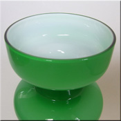 Lindshammar Swedish green 'hooped' glass vase with internal white casing, labelled.