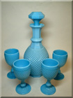 Blue milk glass decanter + goblets set, made in Portugal and sold by designer outlet Casa Pupo in London.